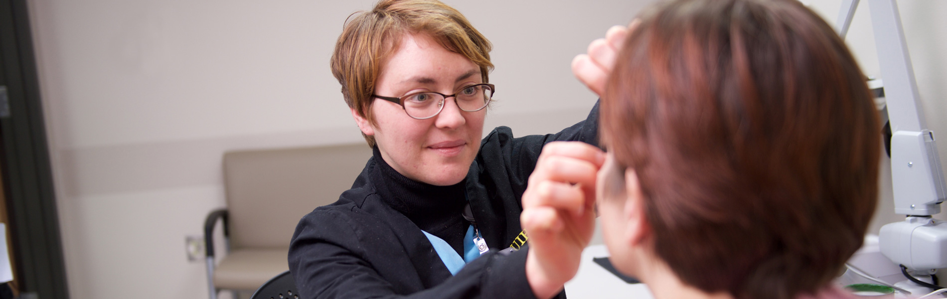 Lindsay Pronk, Ocularist, fitting a prosthetic eye