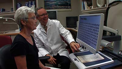 Patient with video magnifier
