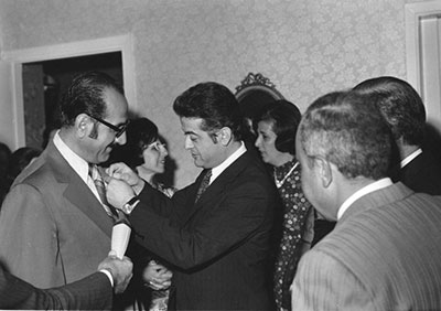 "Lebanese Minister of Health pinning the ""Knight of the Cedars"" medal on Dr. Armaly, 1973"