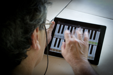 Person playing digital piano