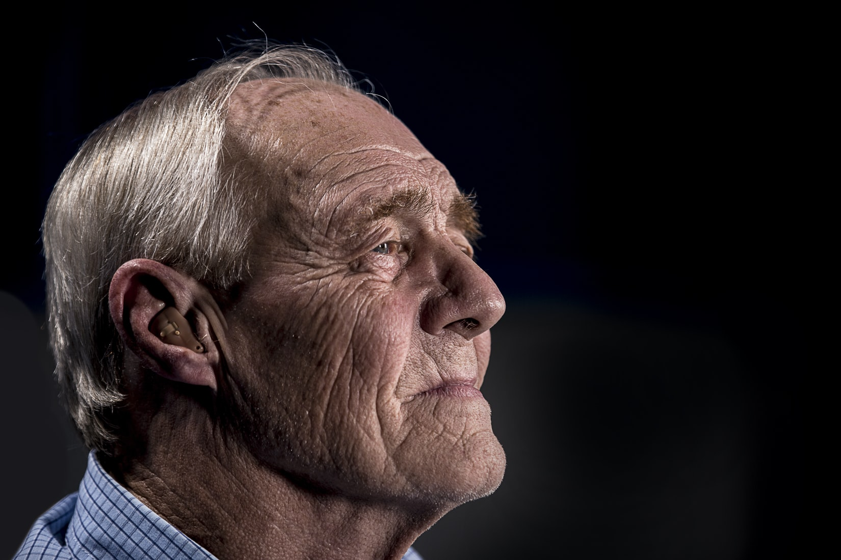 Older man with hearing aid
