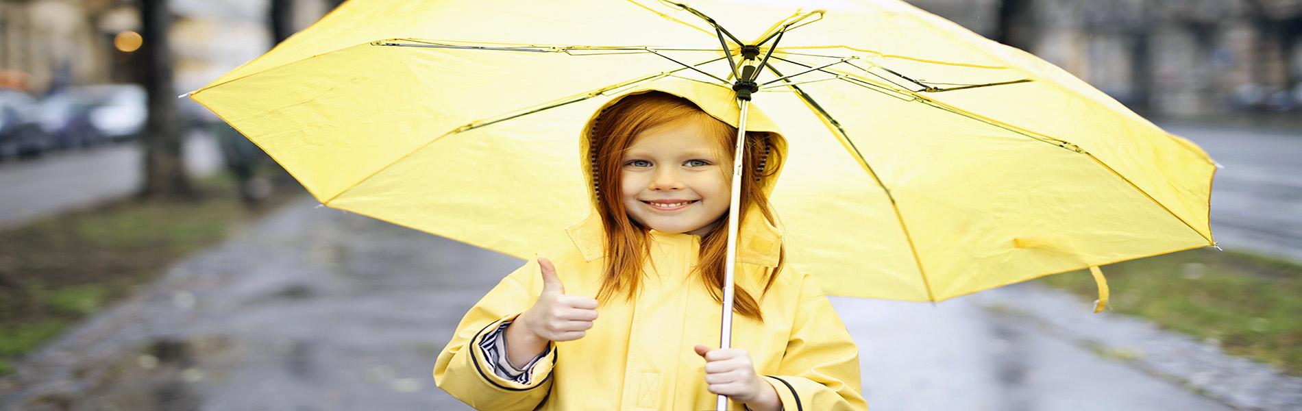 photo-of-smiling-girl-in-yellow-raincoat