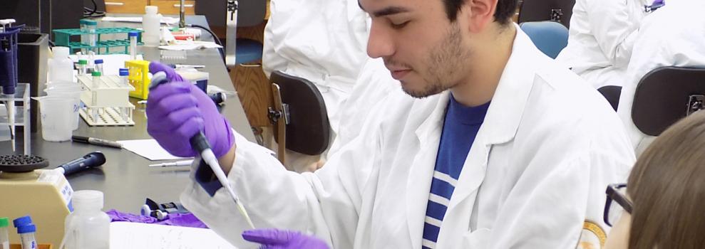 Undergraduate student Juan P Munoz in lab