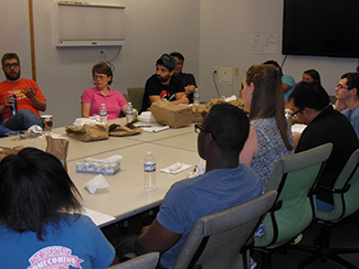 Round table discussion with REU students