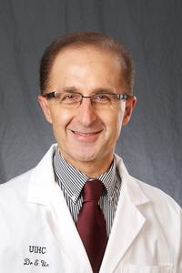 Ergun Uc, MD