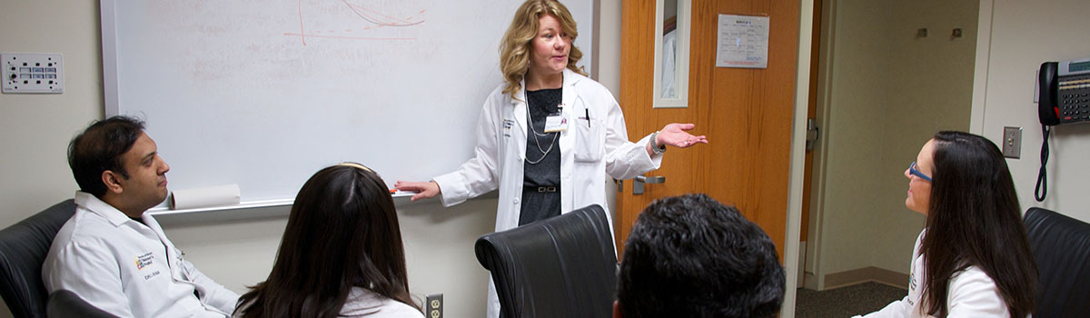 Physician teaching students