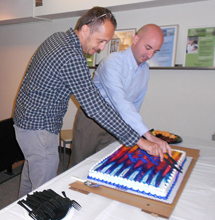 Drs. Badovinac and Bellizzi cutting cake