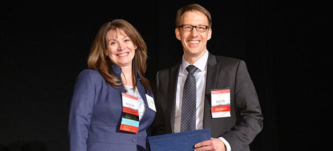 Aaron Bossler receiving AMP Award