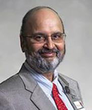 Dr. Karandikar