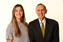 Pictured:  Brooks Jackson, dean of the Carver College of Medicine & Allyson Merfeld, second year DPT student