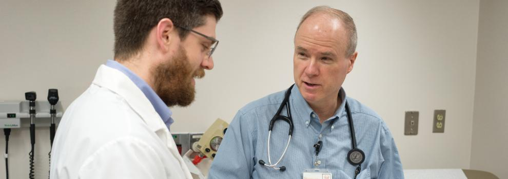 Dr. Dobyns works with a medical resident