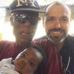 Chris Buresh with Haitian family