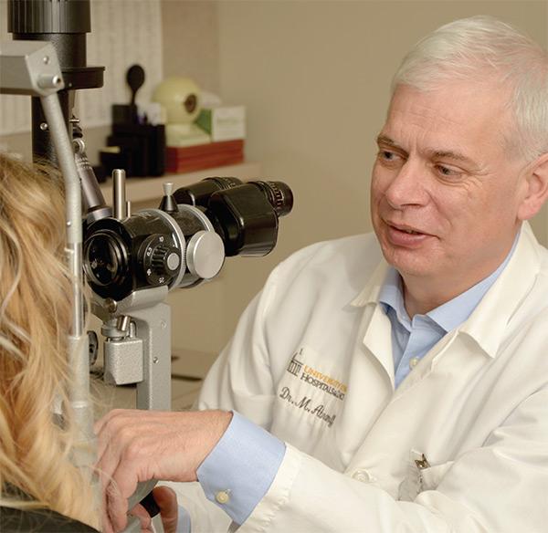 Doctor using eye exam scope