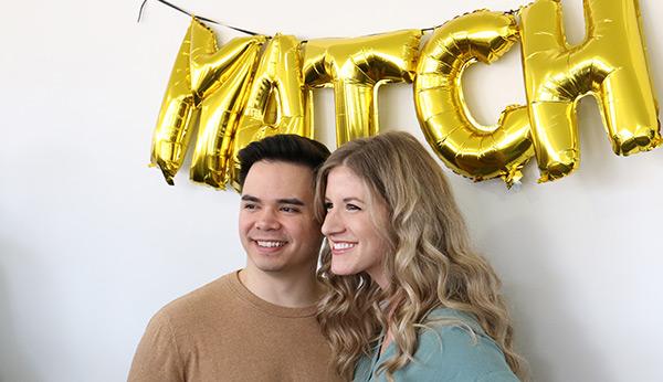 couple under match sign