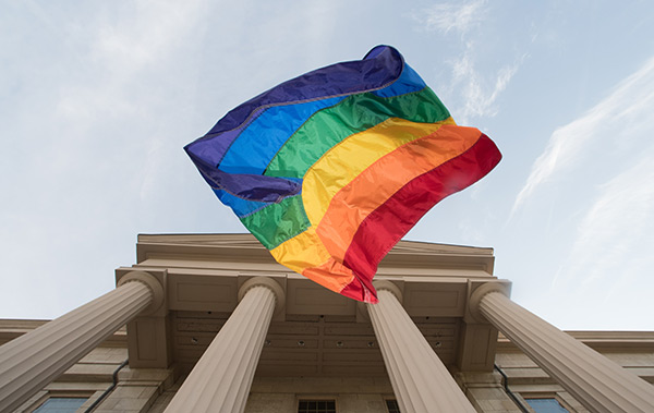 pride banner in front of campus building